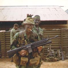 Two US Army Rangers of the 75th Rangers hold M16s with mounted M203 grenade launchers.