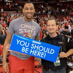 NBA forward Jared Sullinger poses with the You Should Be Here banner #dreamtrips #ysbh #famous #nba