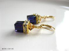 Swarovski Purple Velvet Crystal Cubes, Swarovski Light Colorado Topaz Crystals, Rhinestone Squardelles, Camelot Dangle Earrings. $15.00, via Etsy.