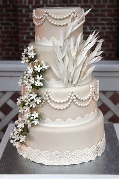 This is the first cake i've seen that i would actually consider- love the ivory fondant with white lace and the pearls!  Great Gatsby inspired wedding cake.