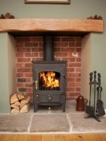 Clearview Pioneer 400 stove, reclaimed yorkshire stone hearth, oak fireplace beam, brick fireplace recess.jpg