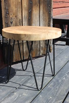 small table made of teak wood and metal