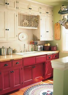 Two-toned cabinets in rustic red and creamy white.