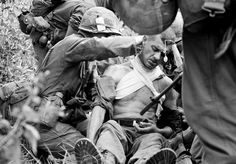 Horst Faas photograph of a wounded soldier getting treatment. ~ Vietnam War