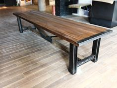 Reclaimed oak trestle table using I-beam legs and custom steelwork. Made by Carbon Industrial Design.