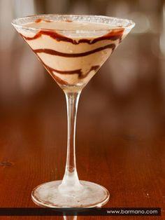 Almond Joy Martini: 2oz Godiva dark liqueur, splash of Frangelico (could use amaretto), 3oz Malibu rum... Shake together with ice, pour into coconut-rimmed glass