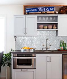 i seriously love this tile mother of pearl oyster white
