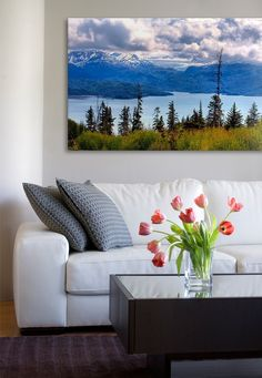 Blow up a landscape picture and hang above the couch. So pretty