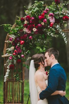 27 Fall Wedding Arches That Will Make You Say 'I Do!': #24. Cute floral and greenery arch in marsala color