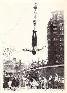 Harry Houdini escaping.