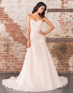 Justin Alexander signature wedding dresses style 9851 A sweetheart neckline adorns this A-line organza gown with opulent beadwork throughout the bodice that continues to the end of the cathedral length train.