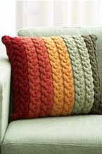 great pattern for a cable knit cushion cover - BUT - I'm thinking that its easy to adapt to use up the stash of autumnal coloured old t-shirts that I have, plaiting then sewing the strips to give a similar effect?