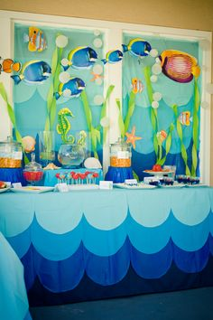 Fish, green streamers, aqua, light, and navy blues for decor.