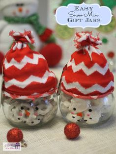 Snowman gift jars - Hat is an old #Christmas sock, face drawn with paint pens, and goodies tucked inside