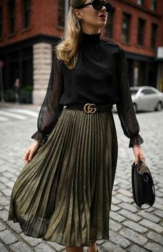 Click for outfit details!  Sheer black mock neck long-sleeve blouse with Swiss-dot detailing, pleated metallic midi skirt, black leather waist belt, black leather structured mini hand bag, cat eye sunglasses and black strappy Mary Jane pumps {Hobbs London, Aqua, Gucci, M2Malletier, Jimmy Choo, holiday style, festive dressing, Christmas 2017, what to wear during the holidays, street style, sparkle, metallics, midi skirt, winter style, wear to work, office style, fashion blogger}
