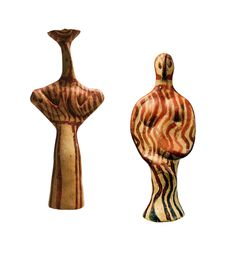 """left: Female figurine of transitional type - Panagia Ridge (1300-1180 B.C.) right: Female figurine of """"Phi"""" type (Φ) (1400-1300 B.C.) Clay likenesses of human figures, animals and all sorts of objects, figurines and figures (called idols) form a unique category of finds which characterize the Mycenaean civilization through their large numbers, distinctive characteristics and charm."""