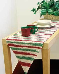 Crochet an accent for a dining table or hallway table with this table runner crochet pattern. Made in self-striping yarn, you will not have to switch balls on this easy crochet pattern.