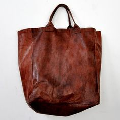 worn leather bag