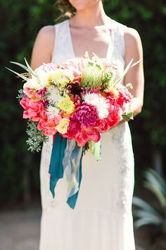 Colorful Los Angeles Fiesta Wedding, Bold Bouquet with Peonies and Protea | Brides.com