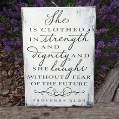 She is clothed in strength and dignity...  Black and white sign on reclaimed wood