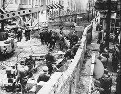 The Berlin Wall being built