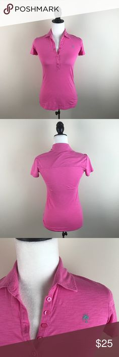 """Lilly Pulitzer Pink Polo Shirt Adorable preppy pink short sleeve polo shirt by Lilly Pulizer. Has a green palm tree logo. Gently worn and in excellent condition with no flaws. 100% pima cotton.  Measurements laying flat— Armpit to armpit: 16"""" Length, shoulder to hem: 24"""" Lilly Pulitzer Tops"""
