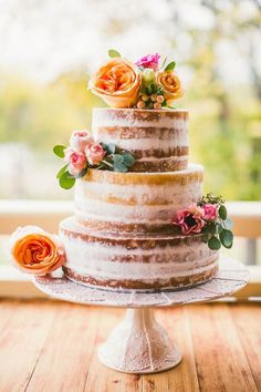 lovely naked cake topped with fresh flowers