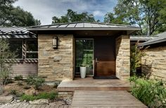msi stone Contemporary Exterior Designs Dallas architects architecture baggett boulders bridge contemporary dallas deck doba domiteaux door dry creek entry entry porch entryway front front door house low profile roof metal roof modern planter residence rocks roof line roof overhang sidelights stacked stone standing rib roof standing seam roof stone facade stone wall wall lighting wood front door