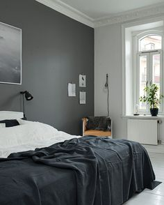 Love the dark grey color framing the bed.