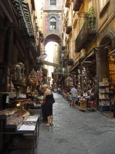 May 21st - Spaccanapoli Quarter, Naples, Italy * In the colorful Spaccanapoli quarter, stroll amid humble shops and time battered workshops and tenements.  Vespas zip along the ancient streets, and vendors hawk everything from contraband DVDs to gelato at the heart of the old city.