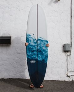"Here's a new Joy for the racks at 1720 Santa Ana Ave... 7'0 Joy model with a clear deck and blue swirl resin abstract on the bottom. This is modeled after our coffee+milk resin swirl boards, but with a more ocean-inspired deep blue. Resin is interesting because when the fiberglass cloth is laid out across the board, whichever color goes down first will saturate the cloth, and essentially ""lock-in"". It's not like having wet paint on a canvas, where you are able to swirl is around until it ."
