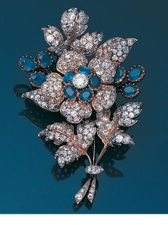 A late 19th century sapphire and diamond floral spray brooch.