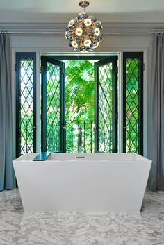 Jeff Lewis Design - Stunning Bathroom Design with Black, Leaded Glass French Doors and a Modern Streamlined Tub. Call it the New Traditional. Bad Inspiration, Bathroom Inspiration, Bathroom Ideas, Bathroom Tubs, Bath Ideas, Bathroom Designs, Dream Bathrooms, Beautiful Bathrooms, Jeff Lewis Design