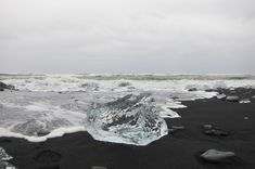 Icy Beach – Jökulsárlón, Iceland. Fire and Ice A black sand beach lies on the southeastern Icelandic coast just outside the glacier lagoon of Jökulsárlón. The black sand is created from the volcanic activity of the island and the changing tides leave small icebergs that have escaped the lagoon along the beach. Click photo to play sound from www.thetouchofsound.com