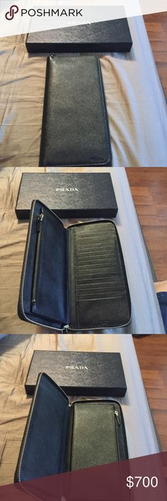 Authentic Prada wallet Large saffiano leather Prada wallet with 17 credit card slots include hard case. Only worn twice, in excellent condition. A staple piece for the large purse lovers. Prada Bags Wallets
