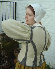 she says it's 17th century dutch - the pilgrims had been in Holland for awhile (page has source paintings and inspiration)