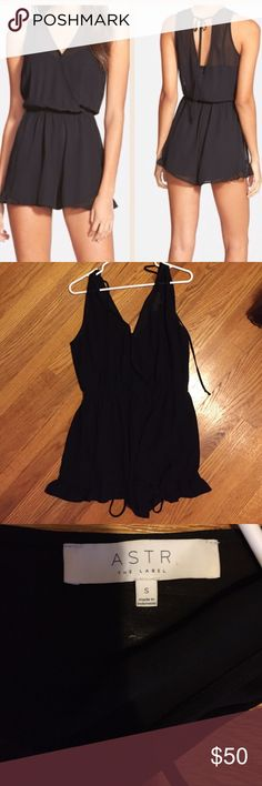 """ASTR Black Sleeveless Romper This chic sleeveless romper flutters with gentle pleats on the surplice body. The nipped in waist creates a figure-defining silhouette. This features a sheer overlay with an opaque lining, a back tie closure, the fabric is 100% polyester, and this is approx. 31"""" length, 2.5"""" inseam, 32"""" leg opening. In great condition. ASTR Other"""