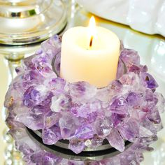 """Amethyst Lotus Candle Holder. Handcrafted with extreme precision this Amethyst Lotus Candle Holder is a piece of art. Purple Amethyst has been highly esteemed throughout the ages for its stunning beauty and legendary powers to stimulate, and soothe, the mind and emotions. It is a semi-precious stone in today's classifications, but to the ancients it was a """"Gem of Fire,"""" a Precious Stone worth, at times in history, as much as a Diamond."""