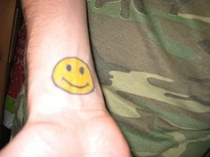 A small smiley tattoo might be cute