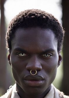 Wow! Strong features. He is handsome look at that dark luscious skin.