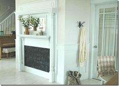 old mantle...chalk board paint...faux fire place by cindy