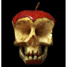 A skull carved out of an apple by Russian-born, Paris-based sculptor Dimitri Tsykalov. The 47-year-old has turned various fruit and veg, including apples, watermelons and cabbages, into ghoulish sculptures for Halloween