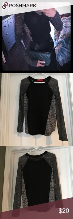 Black sweater with gray detailing from Akira Edgy and fun black knit sweater with gray side panels and sleeves. Looks great dressed up or down. Worn once. Size small; fits true to size. Stretchy material. In great condition AKIRA Sweaters Crew & Scoop Necks
