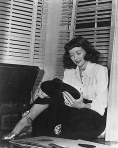 Gloria Grahame listens to records.
