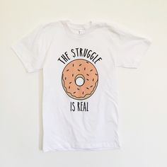 Donut tee These are t-shirts from my business. Please let me know the size you need and I'll let you know if I have it. Tops