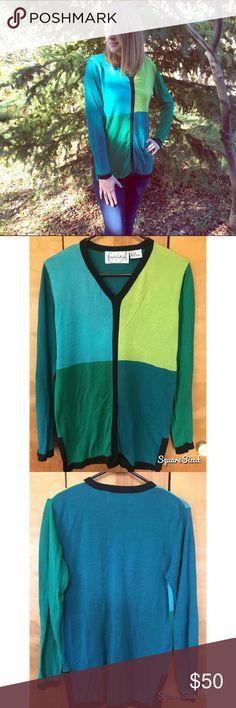 Diane von Furstenberg V-Neck Silk Sweater •Diane von Furstenberg V-Neck Silk Sweater •Blue, Green, Turquoise, Chartreuse, Black Trim •100% Silk •Extra Small Diane von Furstenberg Sweaters V-Necks