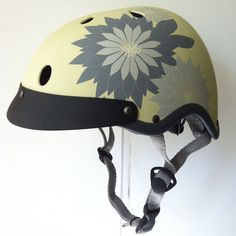 Sawako Furuno Hanabi Helmet (sold by velovixen.com)  The Hanabi is Sawako Furuno's classic design.  Inspired by Japanese patterns of flowers and fireworks, the original Hanabi range sold out earlier in 2012.  However, the new model is back complete with a new visor, looking even better than before. And the quality of workmanship is just as good as ever. £68
