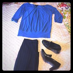 """Nine West trousers & Express top This will be your new favorite work outfit! The Nine West pants (style: slouchy cyndi) are size 2, wide legged with a cuff at the bottom, back flat pockets, and a 32"""" inseam. It's difficult to tell in the pictures, but the thin pinstripes are white and blue (and match the blue in the shirt exactly). The shirt  is a medium from Express, has a really cute band at the bottom, and is 94% polyester & 6% spandex. Price is for both pieces. Make me an offer! Shoes…"""