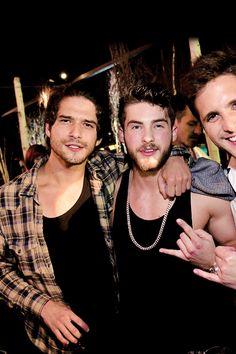 Actors Tyler Posey and Cody Christian attend the annual Midsummer Night's Dream party hosted by Hugh Hefner at The Playboy Mansion on August 27, 2016 in Holmby Hills, California.