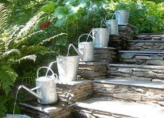 Pilgrim and Pie in France.: Water feature with watering cans !